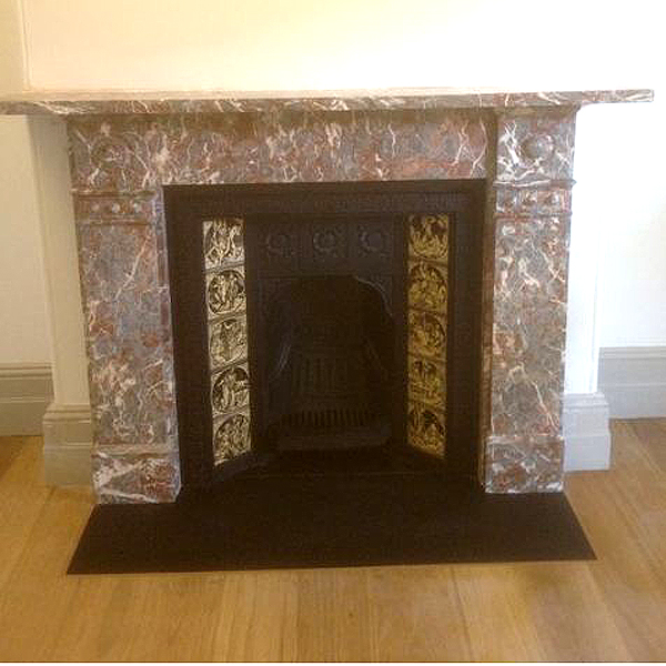 A restored Circa 1880 Rouge marble mantle with honed granite slab hearth.